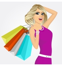 Cheering young woman with shopping bags vector