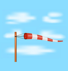 Windsock in red and white design on blue sky vector