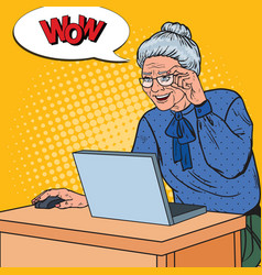 Pop art happy senior woman using laptop at home vector