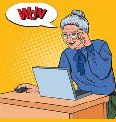 Pop art happy senior woman using laptop at home vector