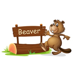 A beaver beside a wooden signage vector image