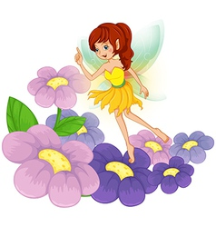 A fairy at the garden with fresh flowers vector