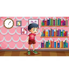 A boy standing beside the wooden shelves with vector image