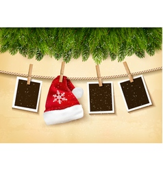 Christmas tree branches with photos and a Santa vector image vector image