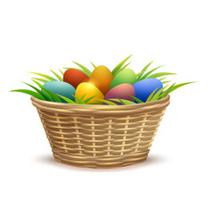 Wicker basket full of easter eggs on grass vector