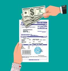 Hand with tax return document and dollar bills vector