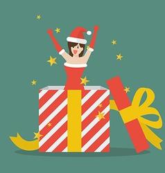 Santa girl out of big gift box vector image