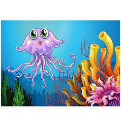 A cute jellyfish near the coral reefs vector