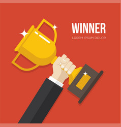 hand holding a golden winner cup vector image
