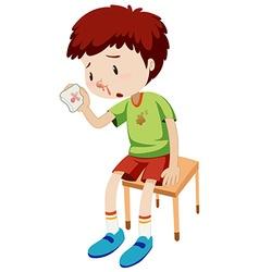 Boy with bleeding nose vector image vector image