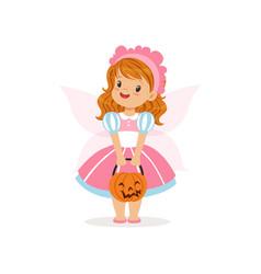 sweet little girl in halloween costume standing vector image vector image