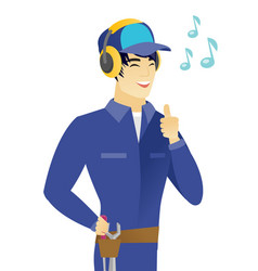 Asian mechanic listening to music in headphones vector