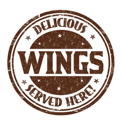 Delicious wings sign or stamp vector
