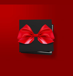 opened black gift box with red bow on red vector image vector image