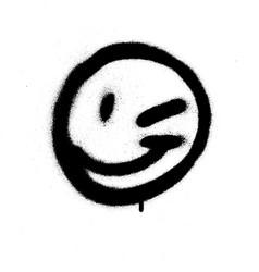Graffiti emoticon wink face sprayed in black vector