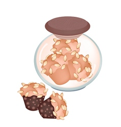 A jar of delicious muffins with almonds vector