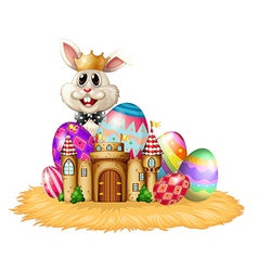 A king bunny with easter eggs vector