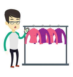 Man shocked by price tag in clothing store vector