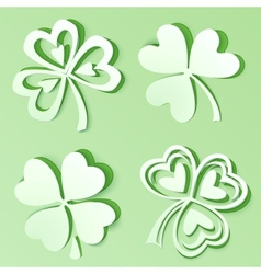 Green cutout paper clovers vector