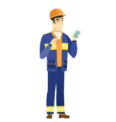 Asian builder holding a mobile phone vector