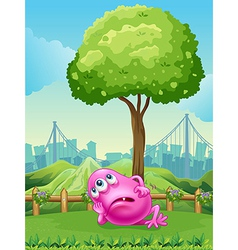 A tired pink monster under the tree vector image