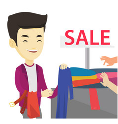 Young man choosing clothes in shop on sale vector