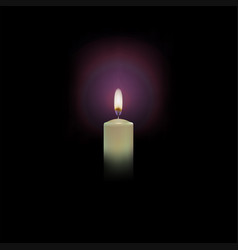 Burning candle on a black background with a haze vector