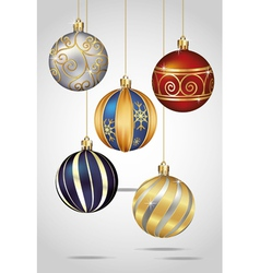 Christmas ornaments hanging on gold thread vector image