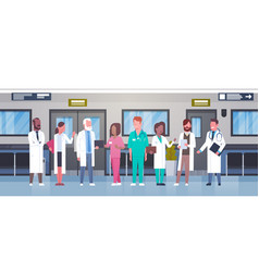 Group of doctors in hospital corridor diverse vector