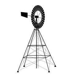 Silhouette of a water pumping windmill vector