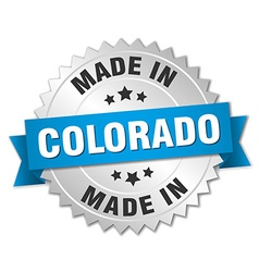 Made in colorado silver badge with blue ribbon vector