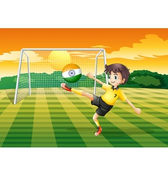 A girl kicking the ball with the indian flag vector