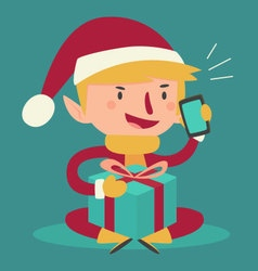 Cartoon elf talking on the phone and holding a pre vector