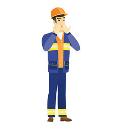 shoked asian builder covering his mouth vector image vector image