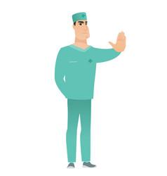 Caucasian doctor showing stop hand gesture vector
