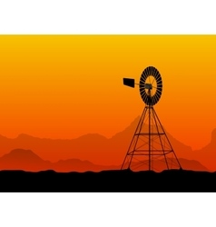 Silhouette of a water pumping windmill at the vector