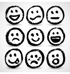 An icon set of grunge cartoon smiley faces vector image