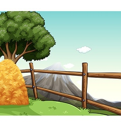Farm scene with haystack by the fence vector