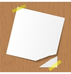 White reminder attached on wooden background vector