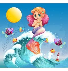 A happy mermaid above the sea waves vector image