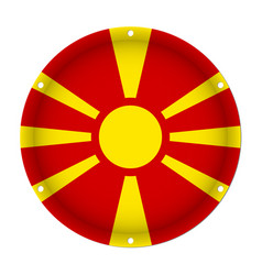 Round metallic flag of macedonia with screw holes vector