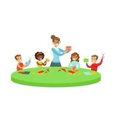 Four Children In Art Class Doing Applique Cartoon vector image
