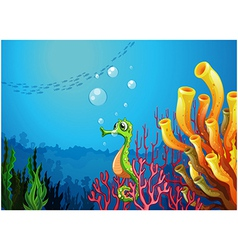 A seahorse near the coral reefs vector image