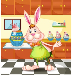 A bunny baking an egg-designed cupcakes vector