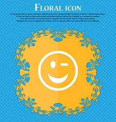 Winking face floral flat design on a blue vector