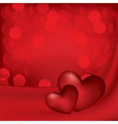 Hearts on the red silk background vector