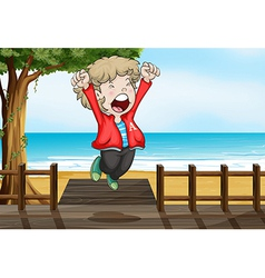 A boy jumping happily in the bridge vector