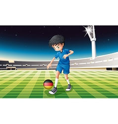 A boy at the field using the ball with the flag of vector image