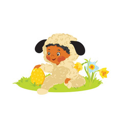 baby boy in lamb costume with decorative egg vector image