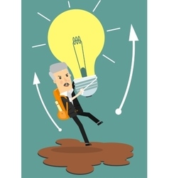 Businessman holds flying light bulb to get away vector image
